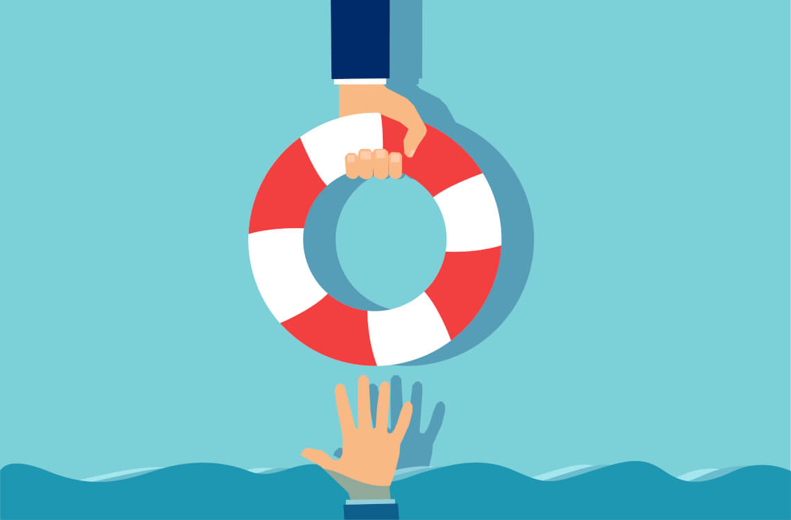溺れている人に浮き輪を差し出す様子