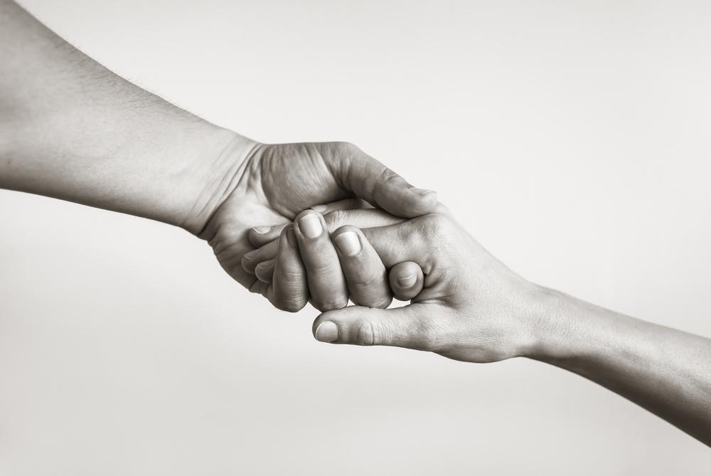惻隠の情をイメージした差し伸べる手