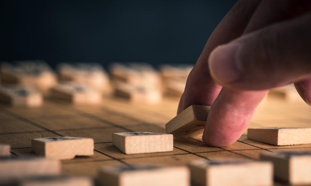 定石に乗っ取り将棋をうつ